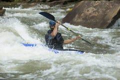 Whitewater Kayaker. Adventurous Whitewater Kayaker in Rapids Royalty Free Stock Images
