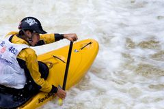 Whitewater Kayaker. Jordan Poffenberger paddles his way downriver during the Steep Creek Championship at the 2010 Teva Mountain Games, held in Vail, CO Stock Photos