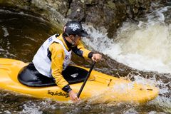 Whitewater Kayaker. Jordan Poffenberger paddles his way downriver during the Steep Creek Championship at the 2010 Teva Mountain Games, held in Vail, CO Stock Images