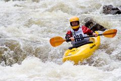 Whitewater Kayaker. Rachel Curtis works her way downriver through a tough section of whitewater during the Steep Creek Championship at the 2010 Teva Mountain Stock Photos
