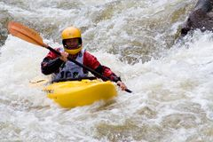 Whitewater Kayaker. Rachel Curtis works her way downriver through a tough section of whitewater during the Steep Creek Championship at the 2010 Teva Mountain Royalty Free Stock Photography