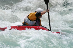Whitewater Kayaker. Extreme action - A kayaker battling strong rapids Royalty Free Stock Images