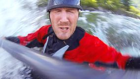 Whitewater kayaking, unique bobble head view stock footage