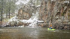 Whitewater paddling in snowstorm royalty free stock photo