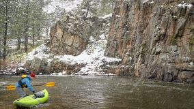 Whitewater paddling in snowstorm royalty free stock images