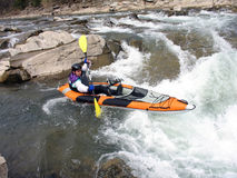 Whitewater rafter. Aswim in whitewater mountain river Royalty Free Stock Photo