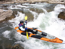 Whitewater rafter close. Whitewater rafter aswim in whitewater mountain river Stock Images