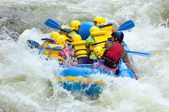 Whitewater Rafting. Whitewater Raft in Class III Rapids Stock Images