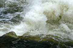 Whitewater Rapids. Water flows through white-water river rapids Royalty Free Stock Photo