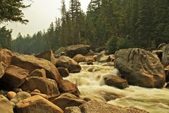 Whitewater Run in Yellowstone National Park. A nice whitewater run in Yellowstone National Park wit a hazy background due to wildfire smoke Royalty Free Stock Photo