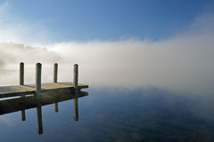 Whitford Lake Dock in Fog. Landscape of dock and autumn shoreline of Whitford Lake, Fort Custer State Park, Michigan, USA stock images
