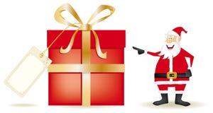Whith de Papá Noel un presente grande Imágenes de archivo libres de regalías