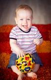 Whith del muchacho una bola Imagen de archivo