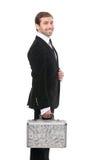 Whith securuty de sourire de garde une valise en métal avec des dollars d'USD Image stock