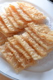Whitish rattle sheet. Chinese Cuisine deep fried whitish rattle sheet Royalty Free Stock Photography
