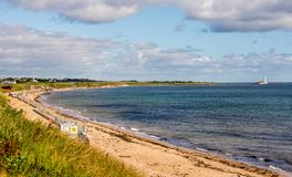 Whitley Bay beach and a lighthouse in a background in a summer day, England. Great Britain Royalty Free Stock Image