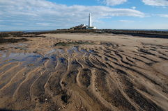 Whitley Bay Lighthouse. Rippled sand at low tide at St Mary's Island Whitley Bay lighthouse Stock Photo