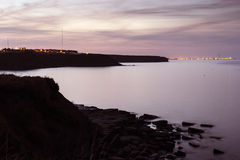 Whitley Bay to Blyth at Dusk. View from Whitley Bay along cliffs to Blyth pier at dusk Royalty Free Stock Images