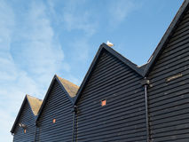 Whitstable, Converted fishermna's huts in the harbour. Royalty Free Stock Photos
