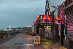 Whitstable Fish Market. Whitstable, UK - November 19, 2014: Dusk falls on the Whitstable harbour Fish Market whose sustainable seafood policy has been endorsed Royalty Free Stock Photography