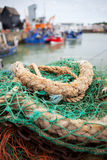 Whitstable harbour fishing trawler. Whitstable bay and fishing harbour. nets and rope with trawlers in background Royalty Free Stock Photo