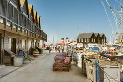 Whitstable Harbour with funnels of paddle steamer. Whitstable, UK - Sep 22 2017.  Tourists walk from the Waverly paddle steamer with distictive red funnels Stock Photos