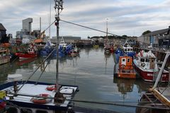 Whitstable Harbour. This photo shows Whitstable Harbour in Kent. Whitstable is famous for it`s Oysters amongst other things and it`s from Whitstable waters they Stock Images