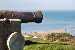 Whitstable. An old cannon looks out over a spit of land called The Street in Whitstable Kent UK Stock Images