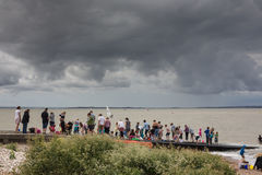 Whitstable Oyster Festival. Whitstable, UK -  July 28, 2014: The children of tourists and locals enjoy a crabbing competion despite the threat of rain during the Royalty Free Stock Image