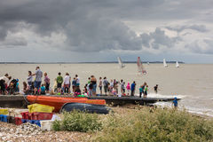 Whitstable Oyster Festival. Whitstable, UK -  July 28, 2014: The children of tourists and locals enjoy a crabbing competion despite the threat of rain during the Royalty Free Stock Photo