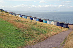 Whitstable sea front. Photo of whitstable sea front showing row of beach huts and isle of sheppey in the distance Stock Photography