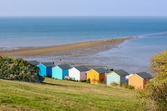 Whitstable beach huts and spit of land called the Street Royalty Free Stock Photo