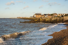 Whitstable, waves and groynes Royalty Free Stock Photos