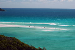 The whitsunday. People standing on a thin beach strip Royalty Free Stock Photos