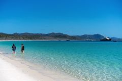 WHITSUNDAYS, AUSTRALIA - AUGUST 24TH: Tourists enjoying the clear blue water and white silicon sand of Whitehaven Beach in the stock image