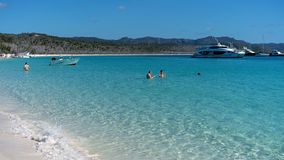 WHITSUNDAYS, AUSTRALIA - AUGUST 24TH: Tourists enjoying the clear blue water and white silicon sand of Whitehaven Beach in the royalty free stock photo