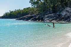WHITSUNDAYS, AUSTRALIA - AUGUST 24TH: Tourists enjoying the clear blue water and white silicon sand of Whitehaven Beach in the stock images