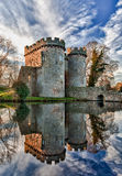 Whittington Castle in Shropshire. Ancient Whittington Castle in Shropshire, England reflecting in a calm moat round the stone buildings and processed in HDR Royalty Free Stock Images