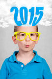 Whiz boy and 2015. Whiz boy with 2015 sign in his head Stock Images