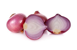 Whloe and half cut red onion, shallots on white Stock Image