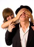 Who is it. The girl has closed eyes to the guy. Guess who it royalty free stock image