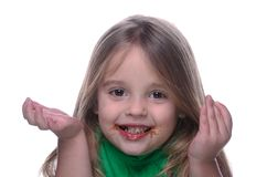 Who ate the chocolate. Young girl with chocolate on her face Stock Image