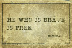 Who brave Seneca. He who is brave is free- ancient Roman philosopher Seneca quote printed on grunge vintage cardboard stock photography