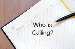 Who is calling write on notebook Stock Photography