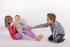 Who can play with the little brother? Siblings rivalry for the s Royalty Free Stock Photography