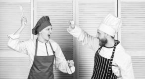 Who cook better. Culinary battle concept. Woman and bearded man culinary show competitors. Ultimate cooking challenge royalty free stock photography