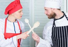 Who cook better. Ultimate cooking challenge. Culinary battle of two chefs. Couple compete in culinary arts. Kitchen. Rules. Culinary battle concept. Woman and stock photo