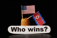 Who country get one`s own way opinions? North Korea or America. Black background stock photos