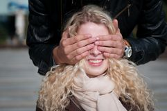 Who is it - covering eyes Royalty Free Stock Photo