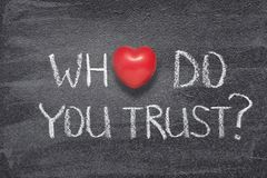 Who do you trust heart. Who do you trust question handwritten on chalkboard with red heart symbol instead of O stock photo